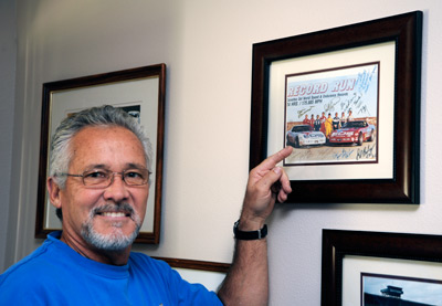 Stu Hayner, in late October, 2009 at his home in Yorba Linda, California with his signed copy of the Record Run Publicity Photo. Image: Author.